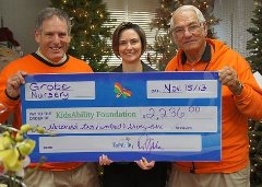 Perry and Peter Grobe with Lisa Talbot, Exec. Director of Kidsability